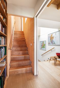 Like the way the bookcases siege into the staircase... delightful