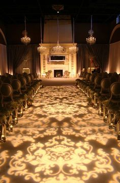 Light up the aisle with a gobo (projection) for a classy feel...