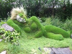 Grass Sculpture In the Garden of Dreams. The sculpture was made by brother and sister team Sue and Pete Hill. There best known works are the series of earth and plant sculptures they made for the Lost Garden of Heligan, Cornwall and for the Eden Project.
