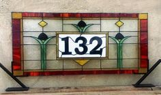 "Stained Glass Address Marker / ""Homelike Tulips"". This custom piece costs approximately $300 - $400. This transom is based on a Craftsman Style design. If you want to give your house a cozy and homely image, you should consider having an address marker like this one. You won't regret at all!!!  Overall size is 17"" tall X 36"" wide for the window shown but we can recreate it in a size and shape that meets our customers needs."