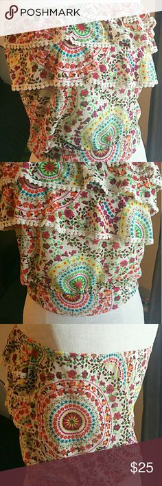 American Rag Multi-color print, elastic top with cute ruffle detail. Perfect for Spring and Summer seasons. Pair with denim shorts and a caramel color sandle or wedge heel! Boho chic! American Rag Tops Crop Tops