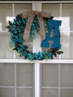 This one is for mom - same thing - wreath, painted letter, choice of flowers and glue gun - done!