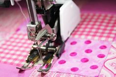 Looking to start quilting with a presser foot? This simple tutorial teaches you how to use a presser foot for stitch-in-the-ditch quilting. We take you from making a quilt sandwich to the completed product in just six steps!