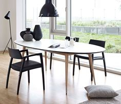 Really like the two-tone legs...wood, with metal feel. Retro Oval Dining Table @warfside.com