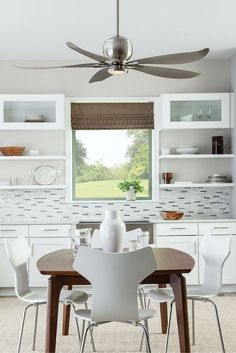 """A floral inspiration takes the sleek, modern aesthetic of the 56"""" Lily ceiling fan by Monte Carlo to a bright and whimsical level. The upward curve of the blade tips and the u-shaped blade irons combine to cleverly use negative space to create a light, airy, organic silhouette. 12W integrated LED downlight and a remote control are included."""