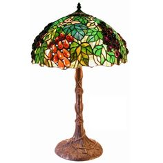 Tiffany Style Jewel Grape Table Lamp has colorful clusters of grapes in green, amber and purple tone colors. It has more than of cut glass individually cut and wrap around copper foil and sol Stained Glass Lighting, Decor, Brown Table Lamps, Glass Lighting Design, Tiffany Style Table Lamps, Glass Shades, Table Lamp, Lamps Plus, Warehouse Of Tiffany