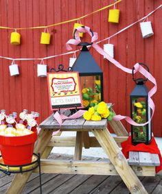 Lanterns could be a cool idea for decor....the white and yellow, not the big black ones. :)
