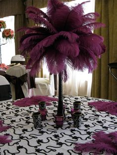 feather wedding table centerpiece (and with peacock feathers, too? Kinda goes with an art-deco theme. Purple Wedding Centerpieces, Wedding Table Centerpieces, Centerpiece Decorations, Reception Decorations, Event Decor, Trendy Wedding, Our Wedding, Dream Wedding, Wedding Ideas
