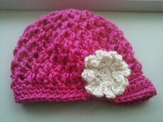 Wicker Beanie, infant to adult sizes $25 (found under Multiple Size Hats category in the storefront) --- shown in photo is a newborn size with a visor and small flower