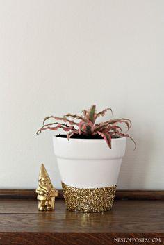 DIY Gold glitter flower pot...tape off section, modge podge, glitter, dry 24hrs, and modge podge over glitter to set