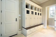 Collection of 22 incredible mudroom ideas, all with storage lockers and/or benches. Mudroom storage helps keep your home entry organized and clutter-free. Mudroom Cabinets, Mudroom Laundry Room, Laundry Room Design, Mudroom Cubbies, Cupboards, Cabinet Doors, Laundry Area, Mudroom Organizer, White Cabinet