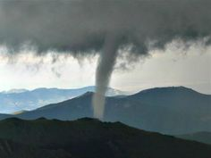 The National Weather Service is reviewing reports and images captured of a rare tornado that touched down on Colorado's Mount Evans over the weekend that could be the second highest ever in elevation on record in the United States. The tornado was reported Saturday afternoon just before 3 p.m. MDT, touching down at 11,900 feet on Mount Evans as strengthening thunderstorms moved over the area west of Denver, according to the NWS.