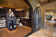 Luxurious Wine Room Eclectic Wine Cellar  by John Kraemer & Sons  Edina, MN, US 55436 · 305 photos  Luxurious Wine Room  http://www.JKandSons.com  Wine room with wood ceiling and massive custom iron doors