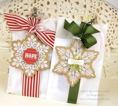 "White bags with ribbon and snowflake decorations - Iove these Maya Road ""Let it Snowflakes"" tags in white on kraft"