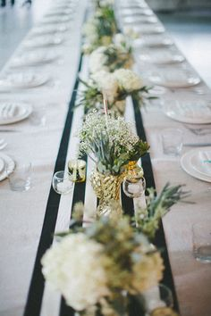 striped table runner, photo by Jenavieve Belair http://ruffledblog.com/glam-ace-hotel-wedding #tablerunners #tablescape #reception