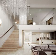 Love the lighting fixture and style of this swanky Miami loft designed by Toronto's Prototype Design Lab.