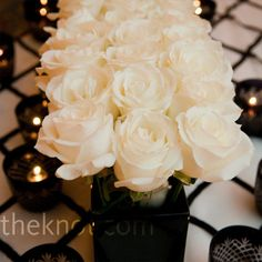 White Rose Centerpieces   A runner of white roses inside a black box gave the sweetheart table its own unique look.