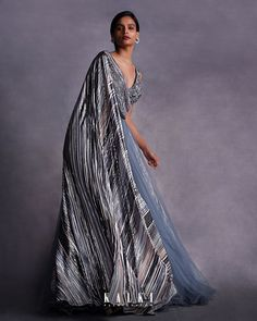 #TheStripesOfFantasy The blue fog one-sleeve gown is inspired by origami-like pleating method! Expertly hand-crafted, it's shaped with flared one-shoulder sleeve and a half-ruching 'V' cut-out front then gathers at the waist before fanning out into a sweeping floor-length hem. Complimented by an aesthetic that is relaxed and low key, but still feels fashion-forward makes this masterpiece a must-have pick for a glamorous after-hours edit.✨