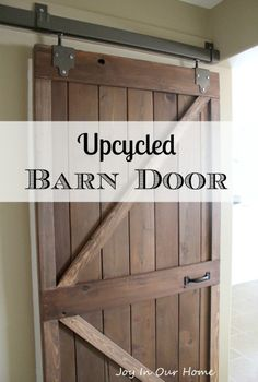 DIY Upcycled Barn Door at joyinourhome... made from an old door and recycled deck boards.
