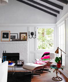 Modern living space with a Eames lounge chair, black fur rug, and a glass side table Stil Inspiration, Interior Inspiration, Bed Of Roses, Living Room Decor, Living Spaces, Living Area, Painted Brick Fireplaces, Paint Fireplace, My New Room