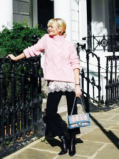 Style Notes:This pink sweater has been taking fashiontown by storm. Pandora Sykesramps up her signature layering prowess by slipping on a little lace slip to peek out from underneath the...