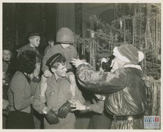 "Photograph. Red Cross Christmas party for Italian orphans on Christmas eve. ""24 Dec. 44. 5/MM-44-32470. Fifth Army, Monticatini, Italy."