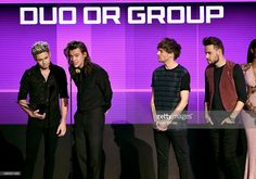 Singers Niall Horan, Harry Styles, Louis Tomlinson, and Liam Payne of One Direction accept Favorite Pop/Rock Band/Duo/Group award onstage during the 2015 American Music Awards at Microsoft Theater on November 22, 2015 in Los Angeles, California.