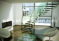 floating stairs, structural glass stairs, helical glass stairs, helical stairs, modern design stairs, custom design stairs http://www.sillertreppen.com/en/siller-stairs/