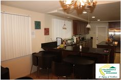 Dining room and gourmet kitchen for the Genesis House by California Home Builders