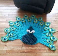 Pavo the peacock rug by Susan Baker, pattern from --> https://irarott.com/Peacock_Rug_Crochet_Pattern.html
