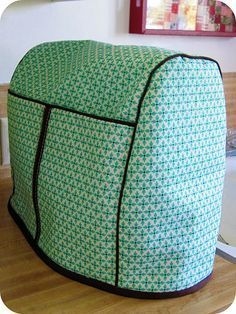 Make your own Kitchen Aid cover. http://sewing.about.com/od/homedecprojects/ss/Free-Pattern-And-Directions-To-Sew-Your-Own-Stand-Mixer-Or-Blender-Cover.htm