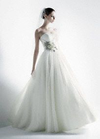 This stunning ball gown offers a beautiful combination of trendy and timeless styling.   Exquisite and unique 3D floral detail adds a modern element to the classic sweetheart bodice.  Tulle over satin ball gown skirt has a soft, ethereal feel.  No train. Available online in Ivory.   To preserve your wedding dreams, try our Wedding Gown Preservation Kit.