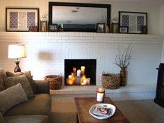 11 Brick Fireplace Makeovers--painting ours white, and the fireplace interior black, would freshen it up.