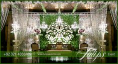 Green reception stage decoration setup planner and designer in Pakistan. Stage Setup arranged and designed by Tulips event management in Lahore Pakistan. #greenstage #greenweddingtheme #tulipsevents #greenweddings #pakistaniweddings For more ideas: www.tulipsevents.com