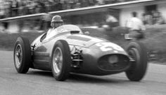 Juan Manuel Fangio at speed down the hill past the pits | Formula 1 photos | ESPN F1 1954