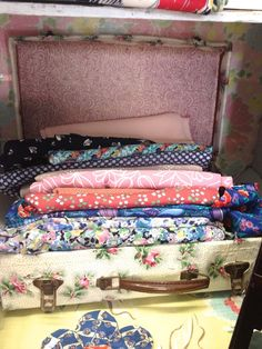 And how cute is that suitcase?! great idea for vintage tablecloth display