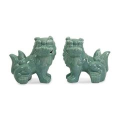 Porcelain Choo Foo Dogs Statues Celadon Color Home Decor  Set of two ceramic choo foo dogs in a polished celadon color finish.  Beautiful decorative accent for your home or office!  We carry an array of complementary decorator pieces to make exquisite home decor settings.