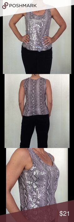 """MICHAEL KORS SNAKESKIN SEQUIN TANK EUC Michael KORS snakeskin print rayon tank covered in clear sequins on front, plain back.   Made of 100% rayon for a beautiful flowy look.  Purplish hue against dark brown snakeskin printed fabric.  Sequins are clear and sewn, not glued!  Pure luxury!  Bust measures 21"""" overall length is 16-1/2"""".  Tagged a petite medium but also would fit a small. Michael Kors Tops Tank Tops"""