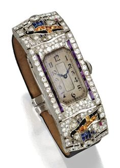 Platinum, Diamond and Coloured Stone Wristwatch, Circa 1925. Movement signed Longines and numbered, clasp with French assay marks and maker's mark. #ArtDeco #watch #Longines