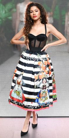 Confession: We couldn't stop staring at Zendaya in this whimsical Dolce & Gabbana corset dress. The ultimate girl crush styled it with classic pumps and ultra-luxe gold earrings. Look of the Day - Zendaya from InStyle.com