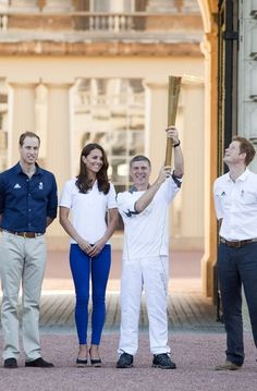 Will, Kate and Harry receive the Olympic Torch