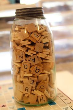 two favs: scrabble tiles & antique ball jars :) couldn't resist using leftover scrabble tiles in a large ball jar & smaller one. they're standing on a wooden crate next to a frame in the studio & boy, do they inspire me :)