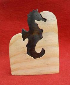 Artesanato Paraty - Artesanato em madeira: Cavalo Marinho 12x9cm R$ 14,00