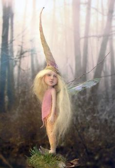 .Reminds me of my granddaughter, Michaela, who needs only wings to look even more fey than she does already!