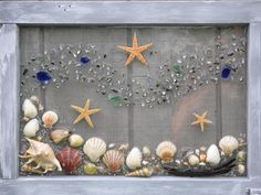 Under the Sea is a handcrafted Starfish, Sea Shell & Beach Glass design. Set in antique re-purposed rustic cabinet. Dimensions 18 x 48 x 1 weight 11.2 lbs