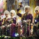 Mardi Gras masked float riders.