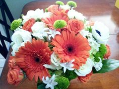 White Hyacinth, White Anemones, White Roses, Coral Roses, Coral Gerbera Daisies, Green Button Mums & Green Foliage Wedding Bouquet