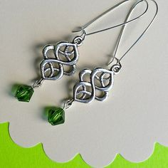 $8.00.  Celtic Swirl.  I own these and love them.  WAY more beautiful in person.  They look like sterling.