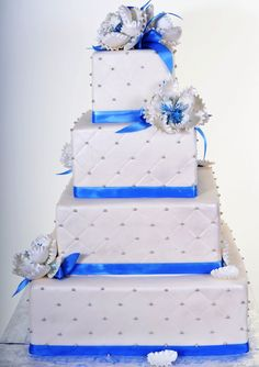 Pastry Palace Las Vegas - Wedding Cake – Squarely In Place. Square white tiers with blue ribbon, blue and white flowers, silver quilting/tufting. Blue Square Wedding Cakes, Different Wedding Cakes, Elegant Wedding Cakes, Wedding Cake Designs, Cream Wedding, Blue Wedding, Wedding Ideas Board, Wedding Planning, Las Vegas Cake