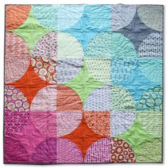 Modern Patchwork Magazine - June 2015 - Zen Chic- The pattern uses a drunkard's path block. It requires a layer cake and some solids. You will sew 36 blocks and each of the blocks uses one layer of the 42 fabric swatches of a layer cake (so you'll have some left overs for a pillow). The large circles show the different fabric designs beautifully – don't sew this quilt with just blenders, use your most favorite prints and let them show up. Since my fabric line has a wide variety of colors I…